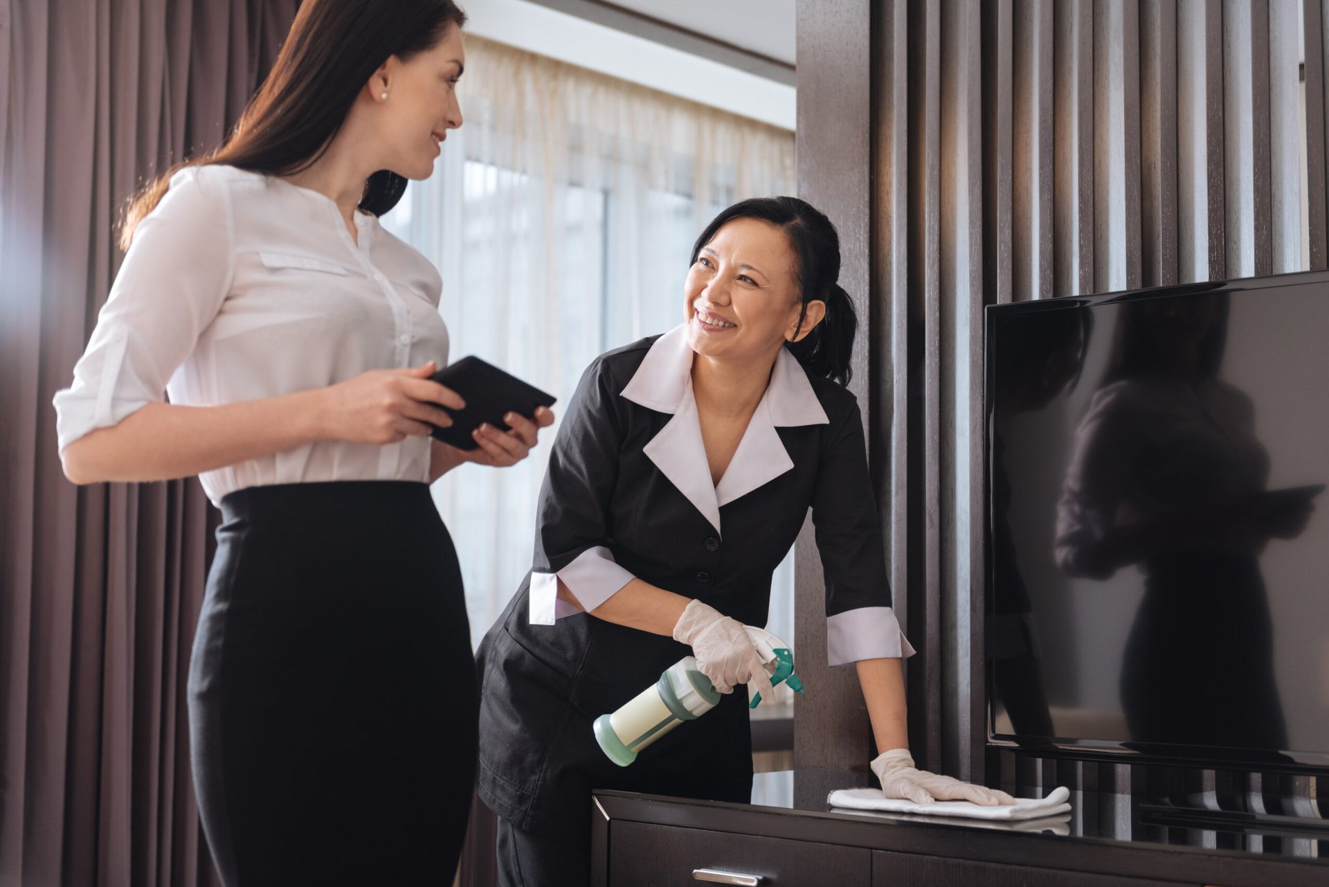 Woman talking to hotel maid