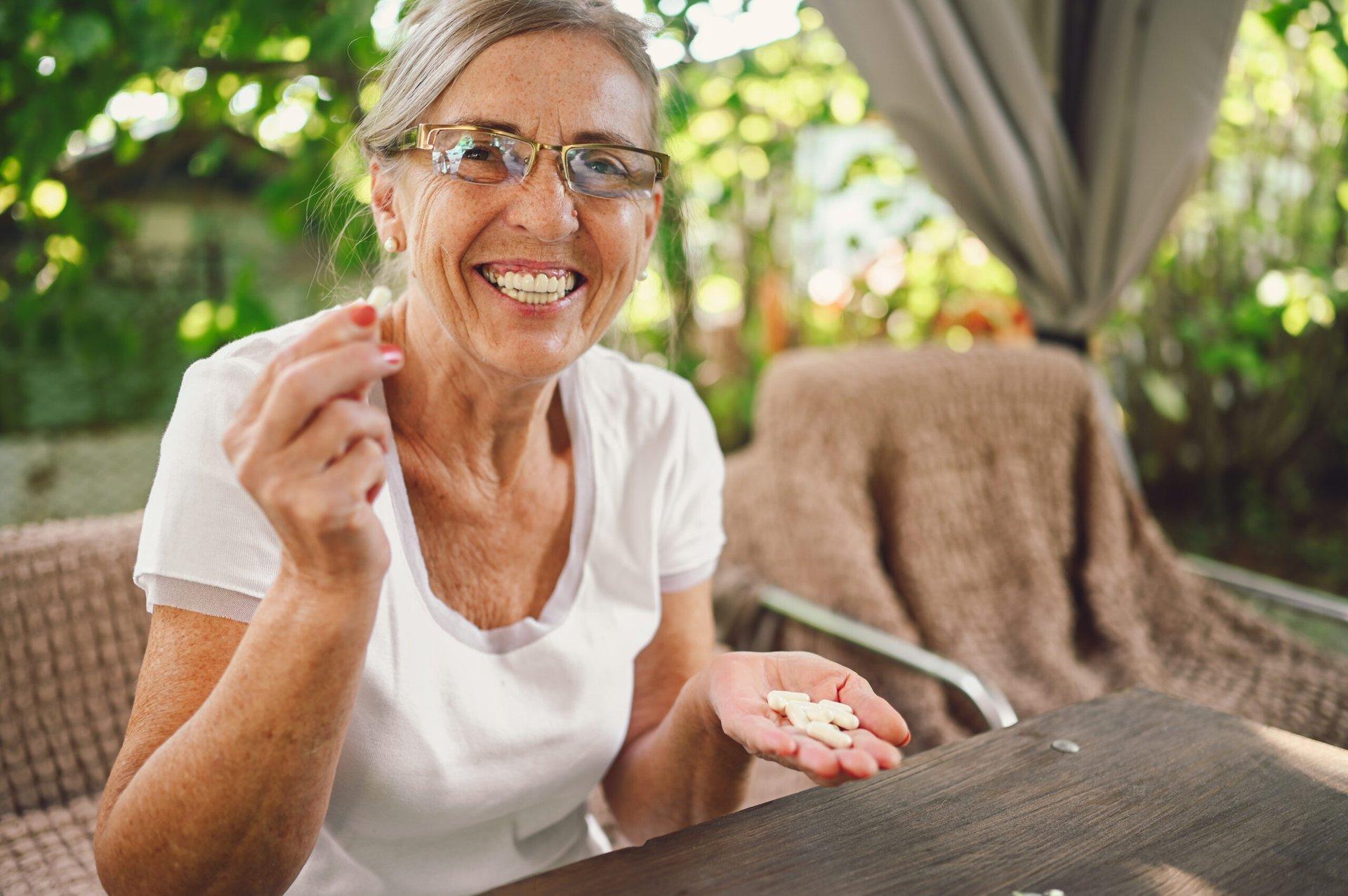 Elderly woman with prescription drugs