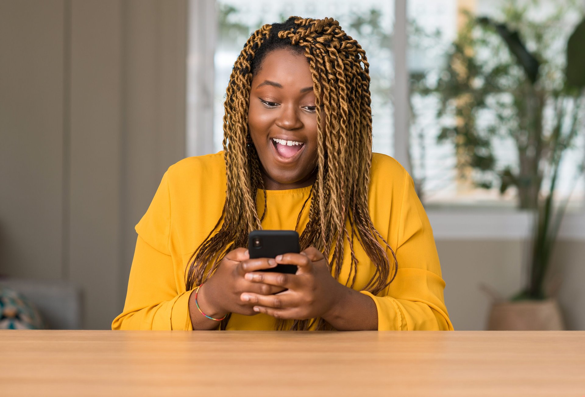 Excited woman looking at her phone
