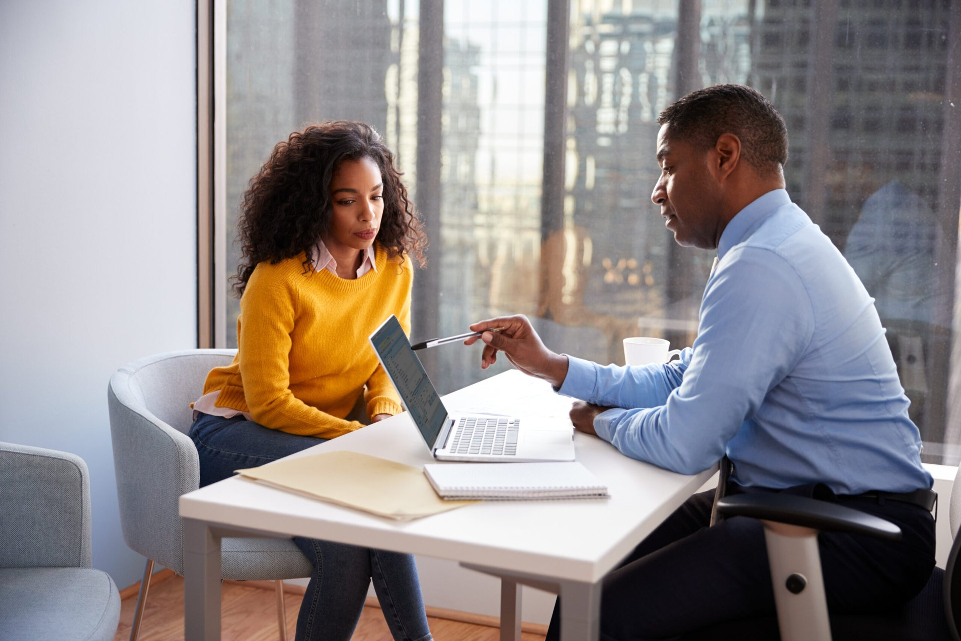 Woman meeting with financial adviser