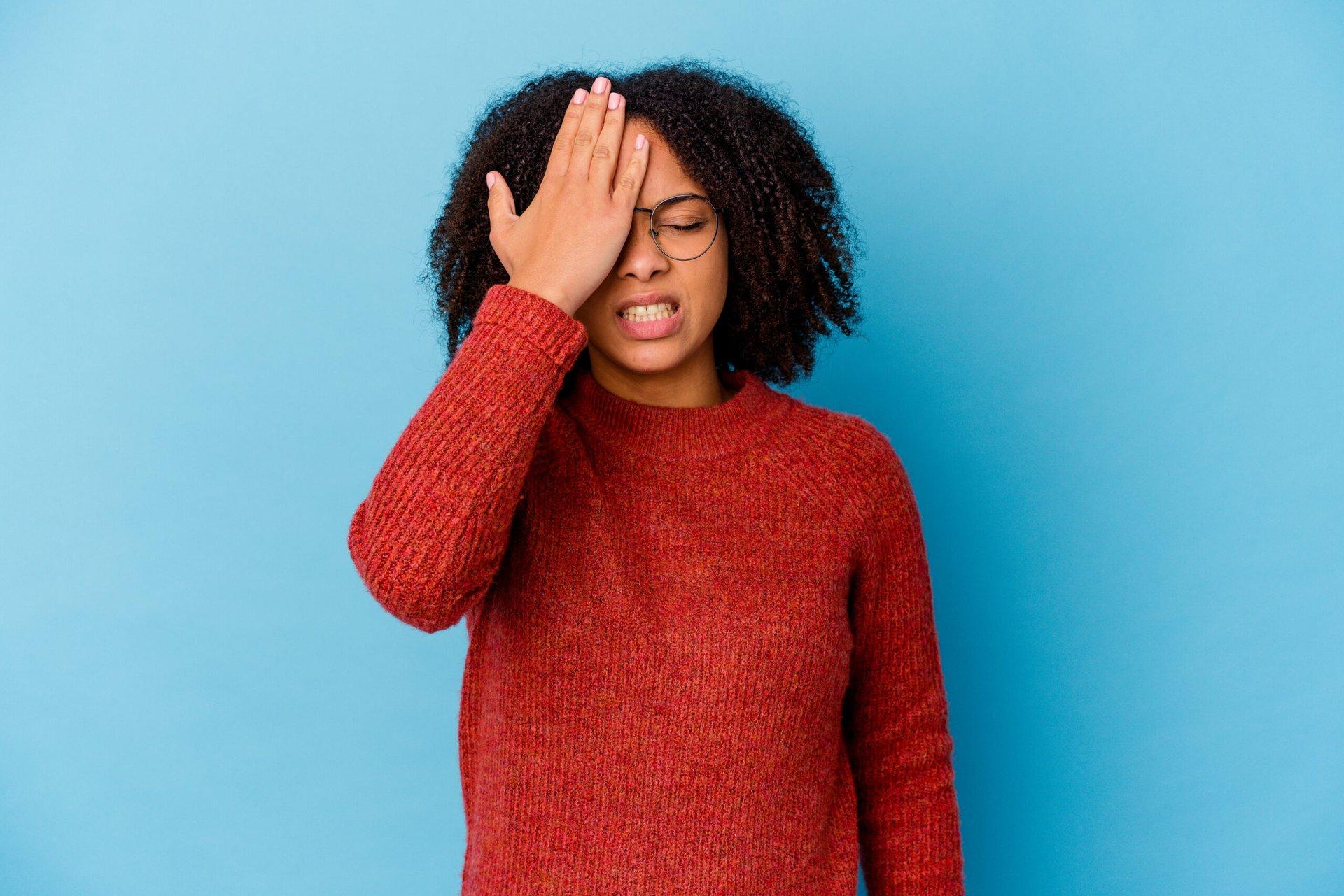 Woman slapping forehead