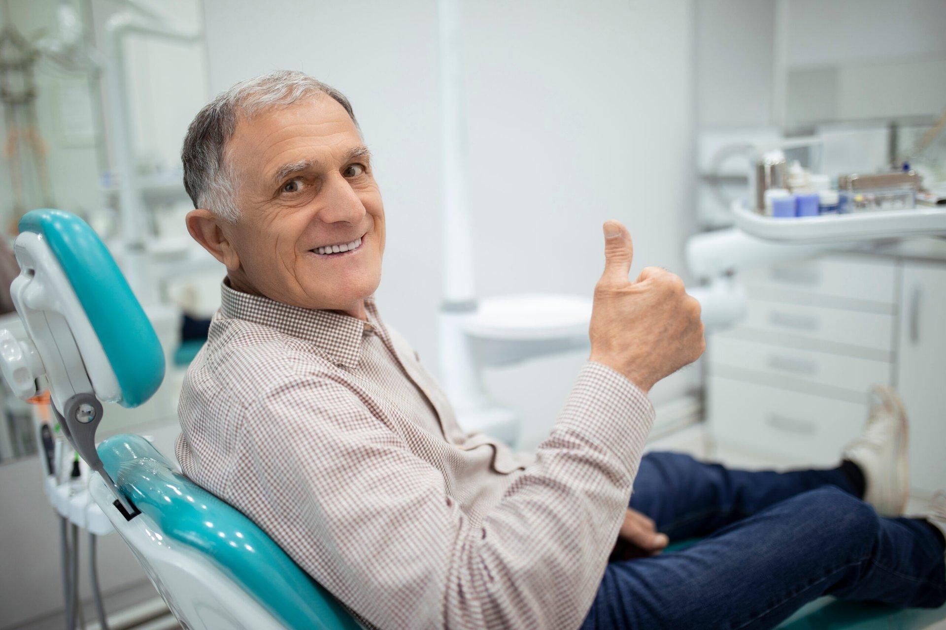 Happy senior at the dentist