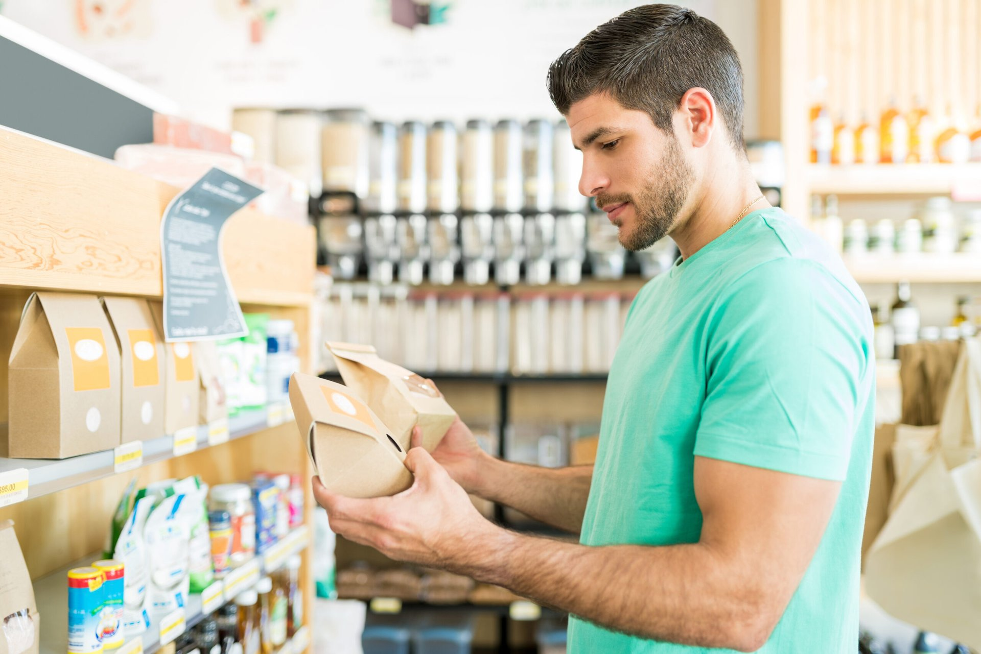 Shopper comparing products at the grocery store