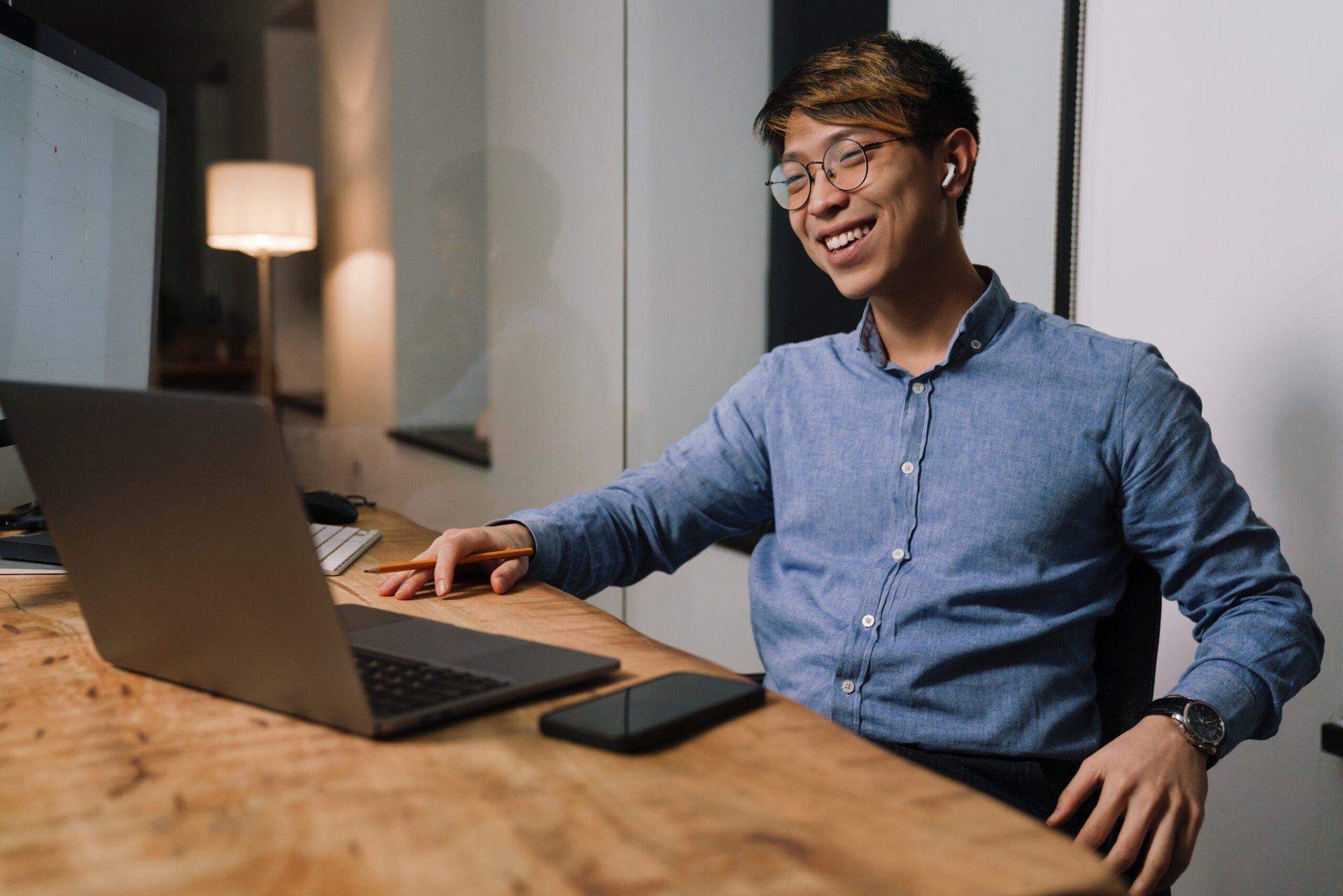 Happy guy at his computer