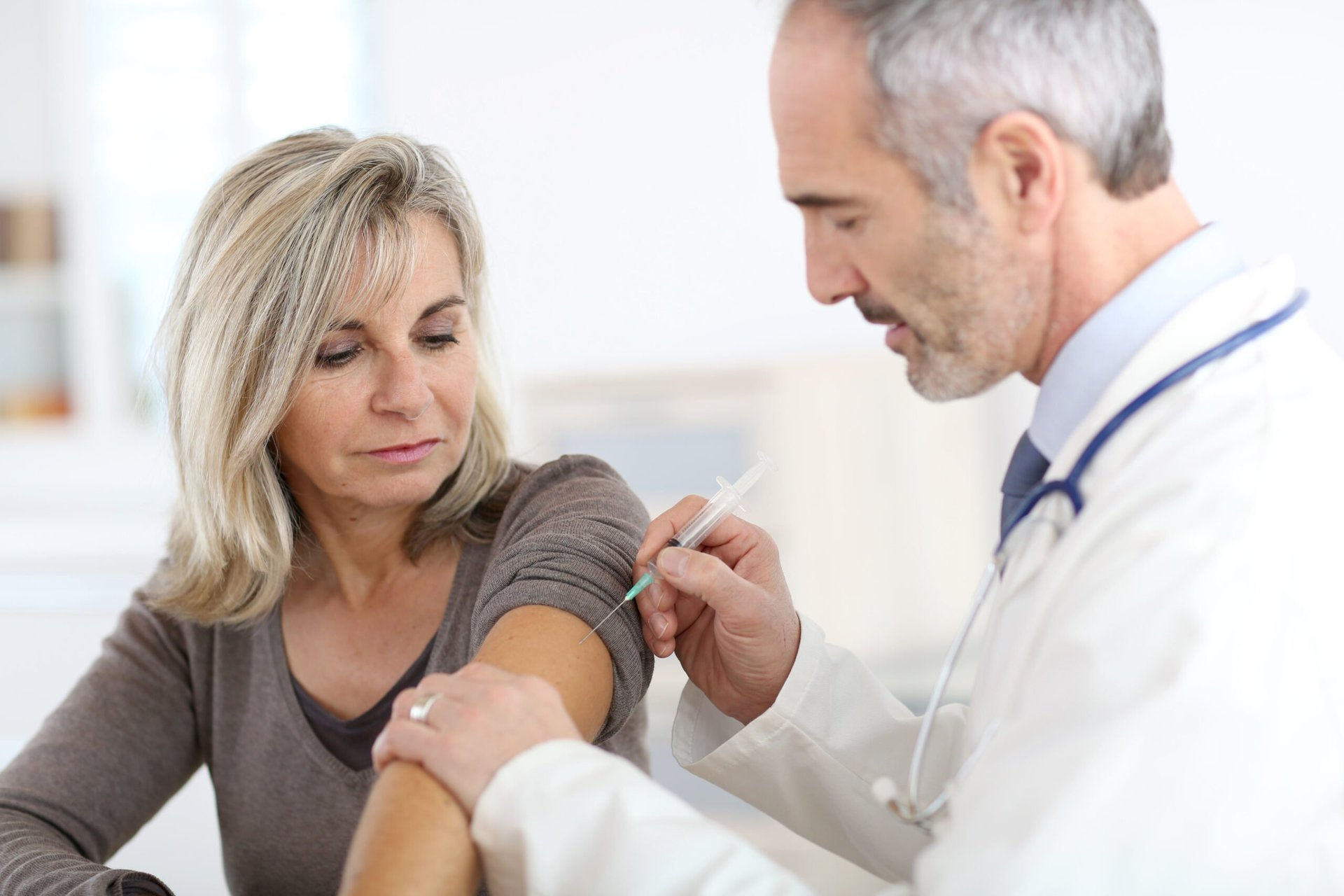 Woman getting flu vaccine