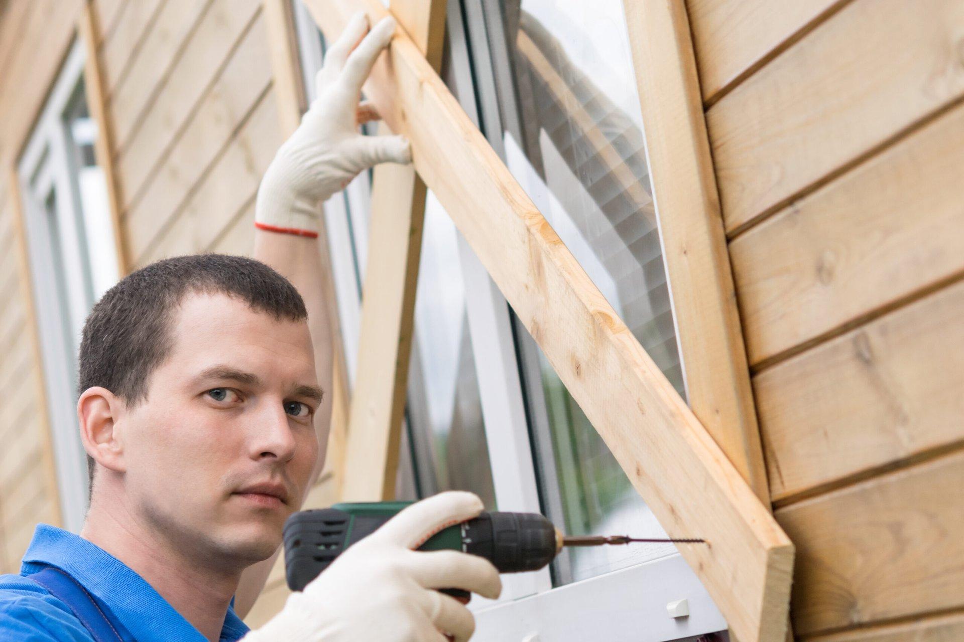 Man preparing home for a hurricane