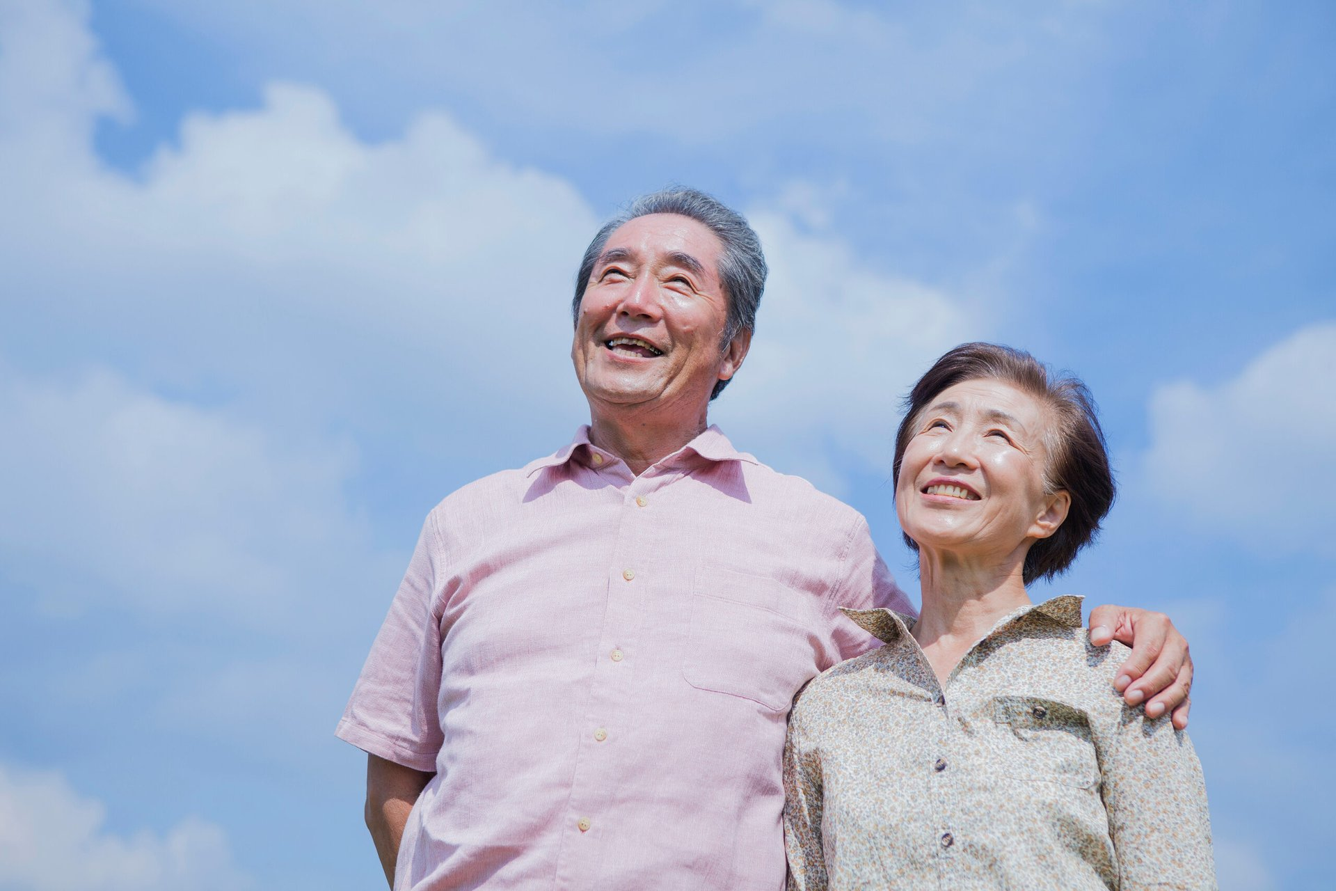 Senior couple under blue skies