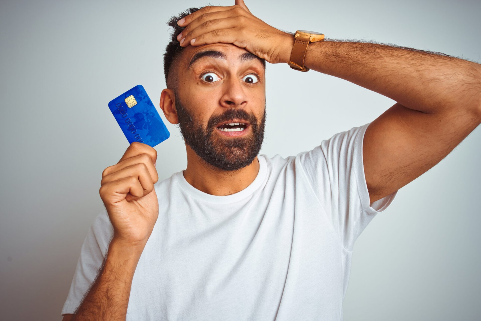 Confused man with credit card