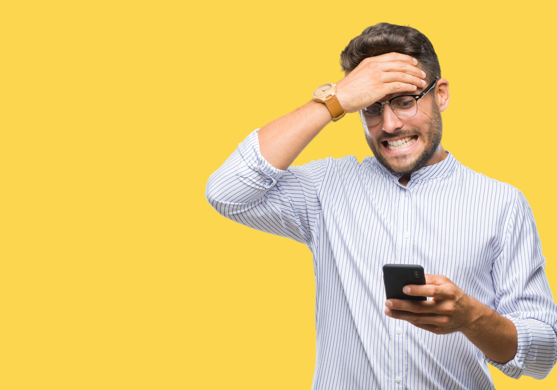 Man freaking out about his phone bill and worried or upset