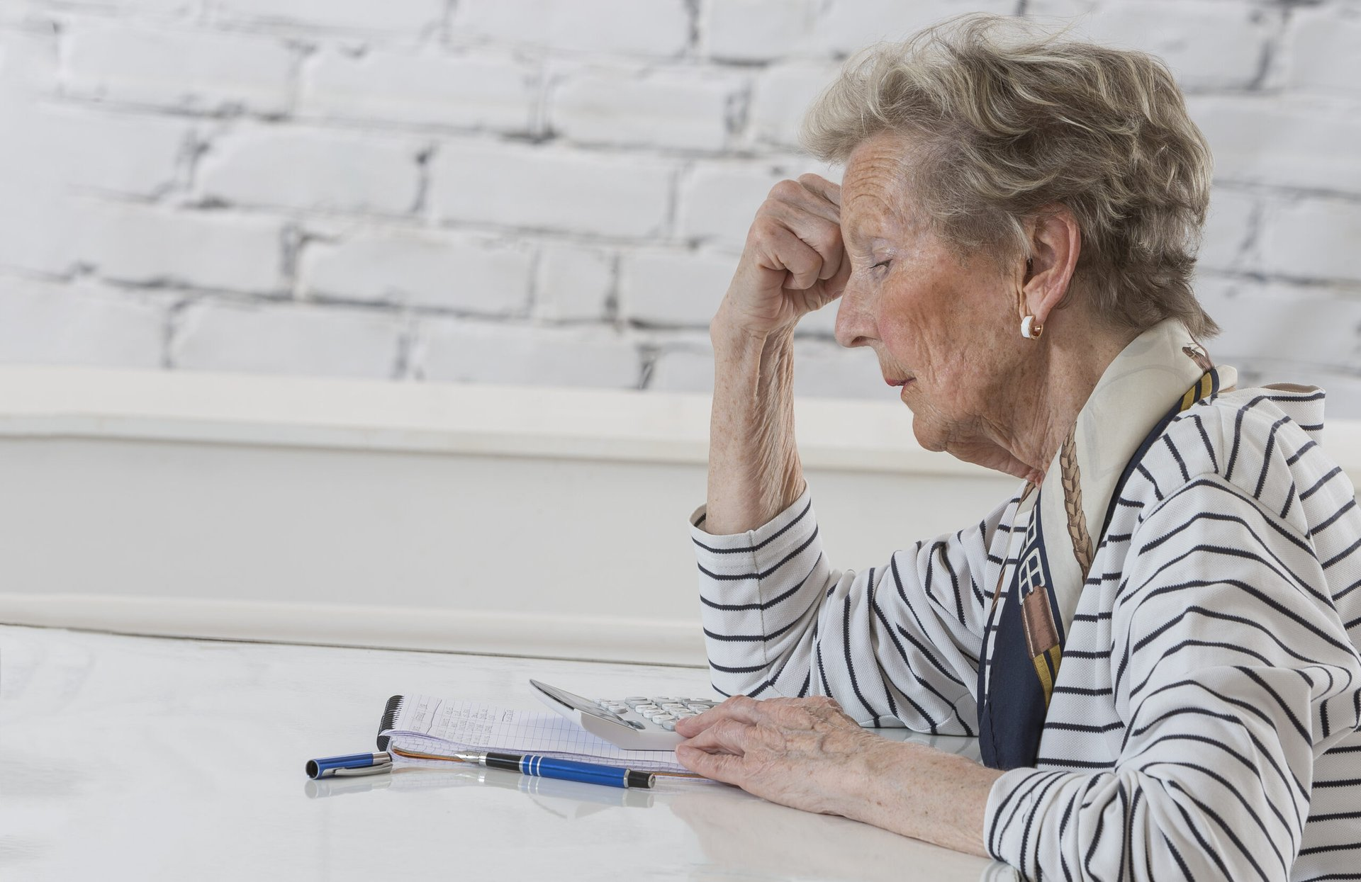 Stressed senior worrying about finances