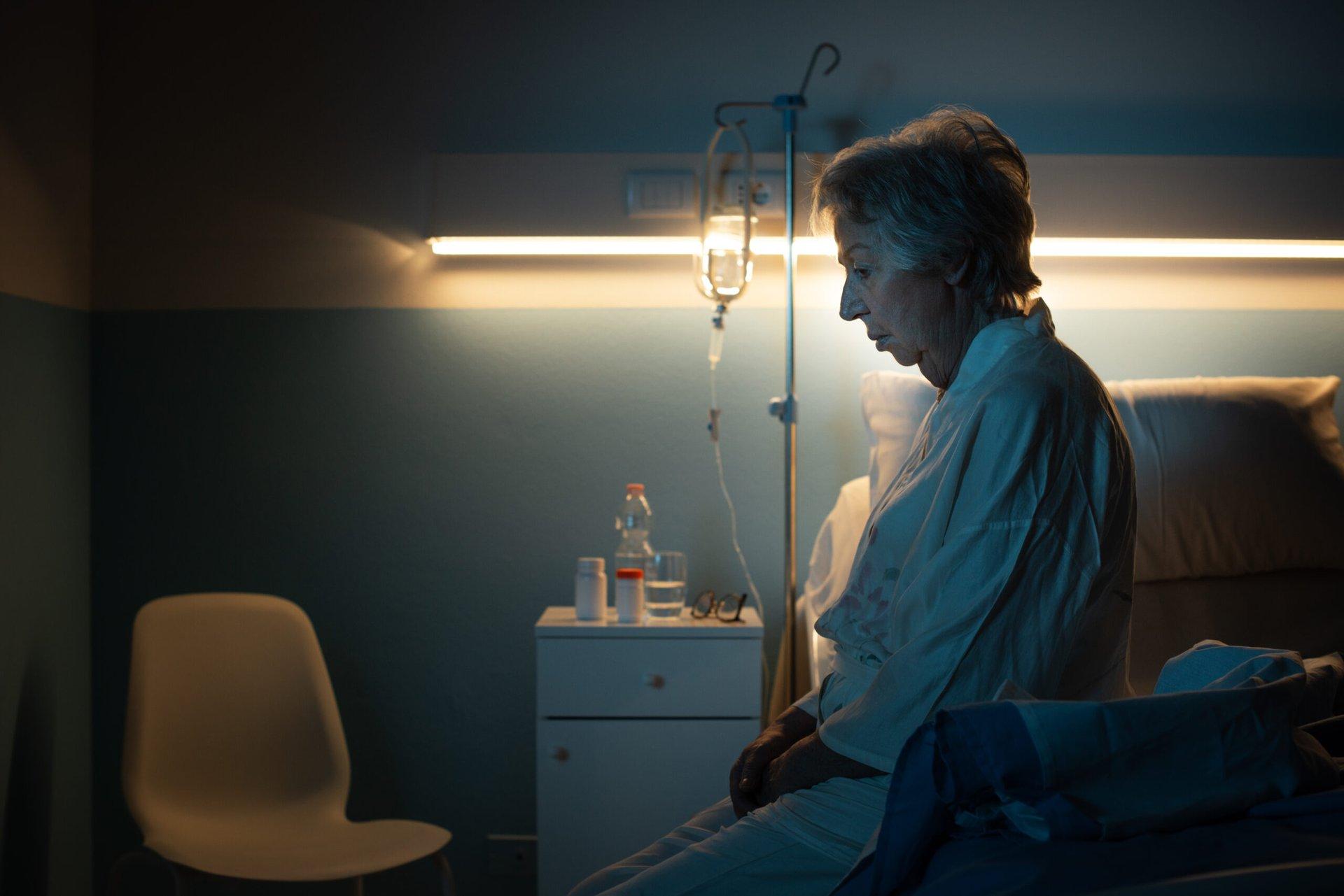 Worried senior on a hospital bed