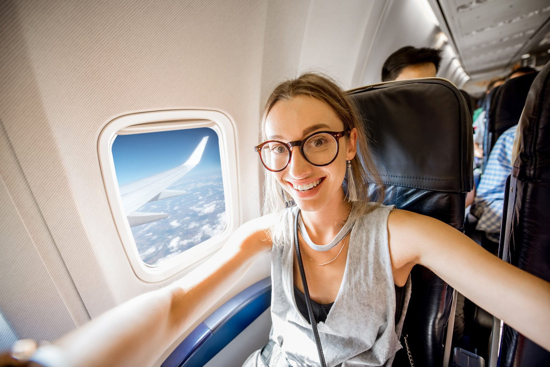 Happy woman on airplane