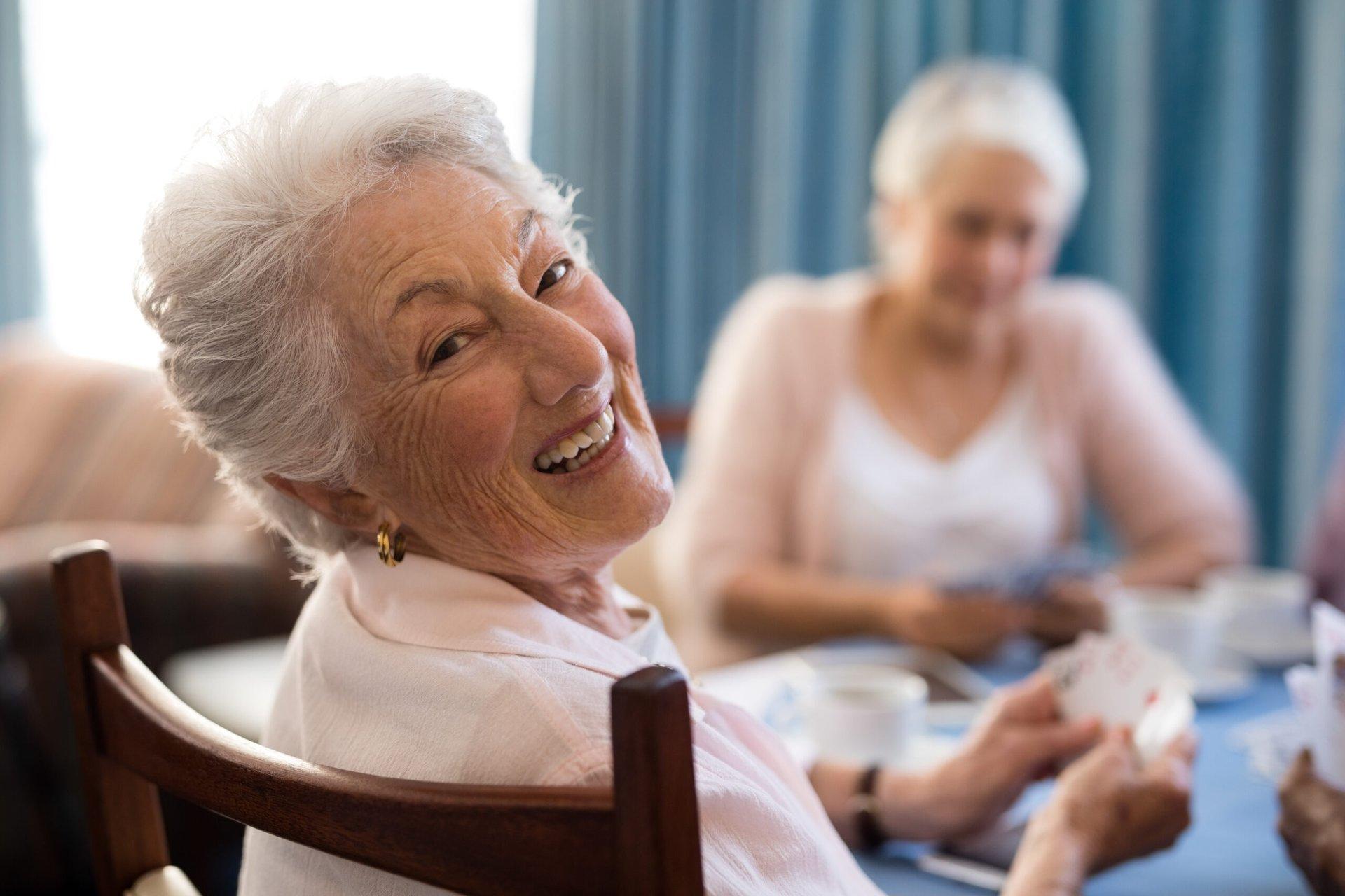 Senior playing cards at a nursing home