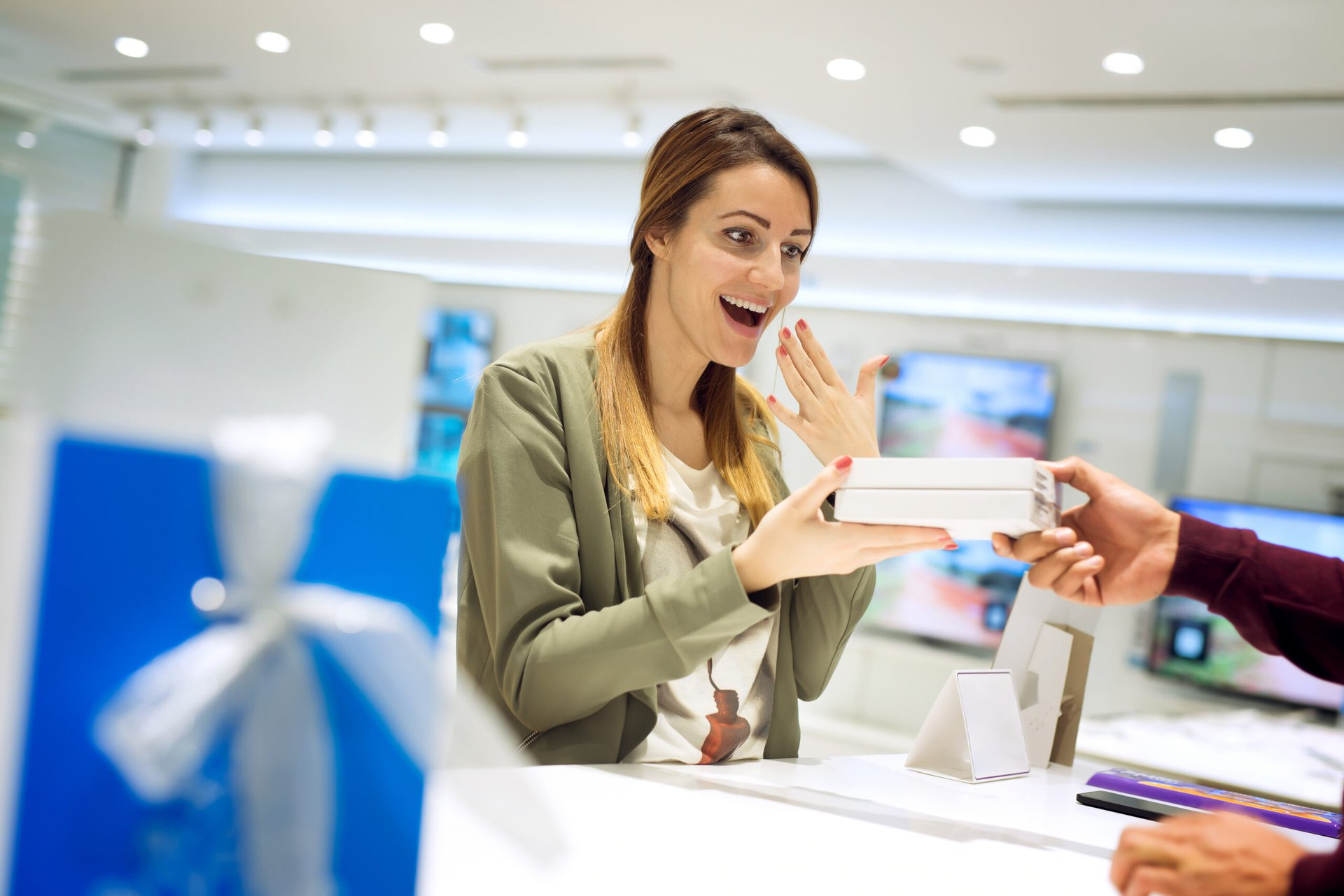 Woman excited about her new cellphone