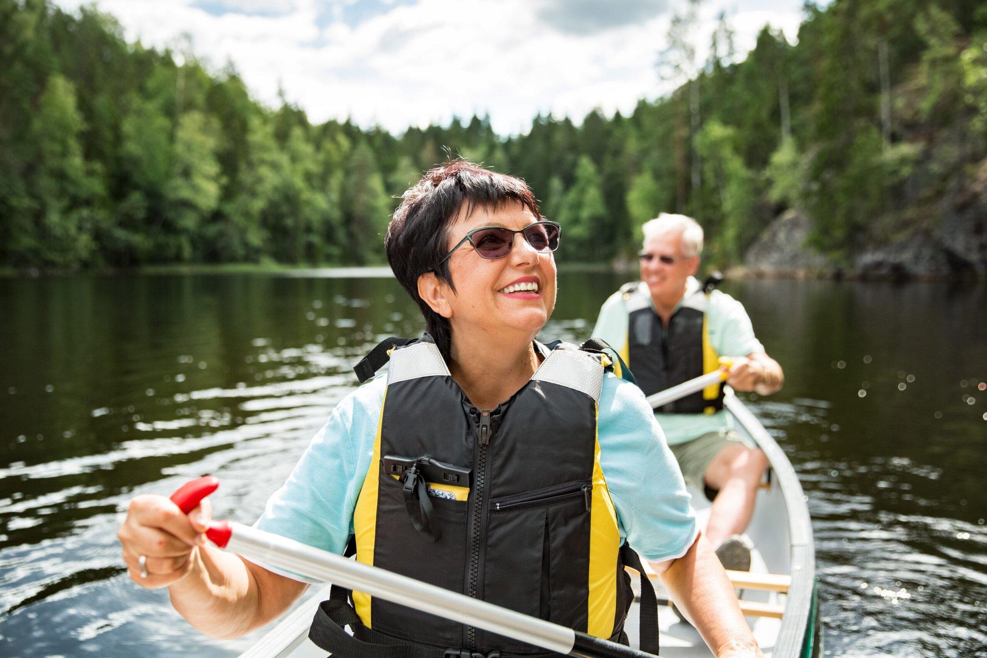 Happy senior couple in a boat
