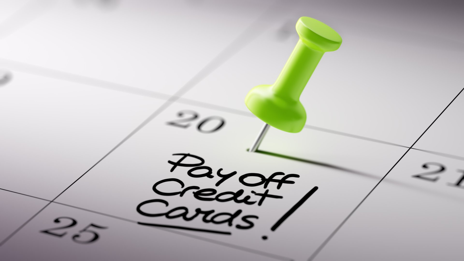 """Calendar with pushpin on """"payoff credit cards"""" note"""