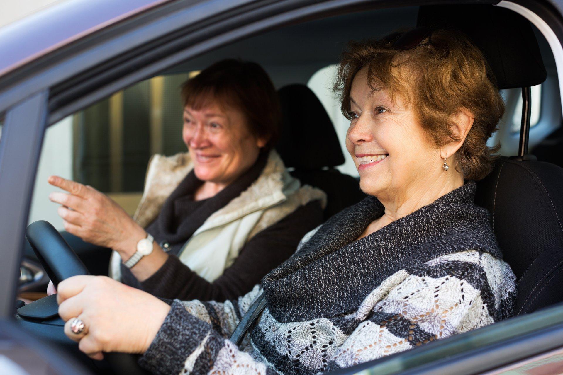 women in a car