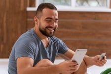Man looking at credit score