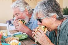 Seniors eating bad food