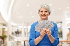 Senior woman holding money