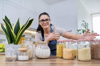 Woman with glass storage containers