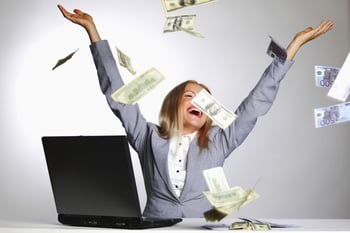 Happy woman surrounded by money