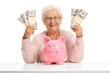 Happy older woman with money.
