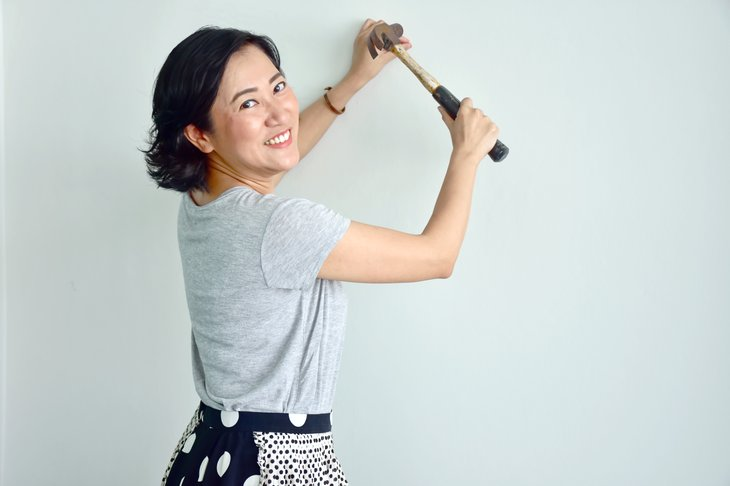 Asian woman with hammer