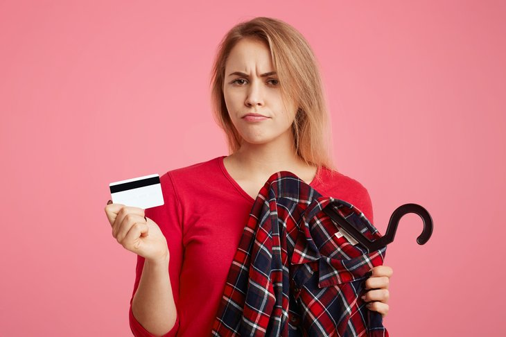Sad woman with credit card