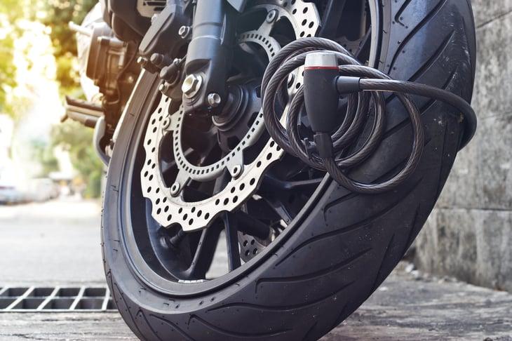 Lock on motorcycle wheel.
