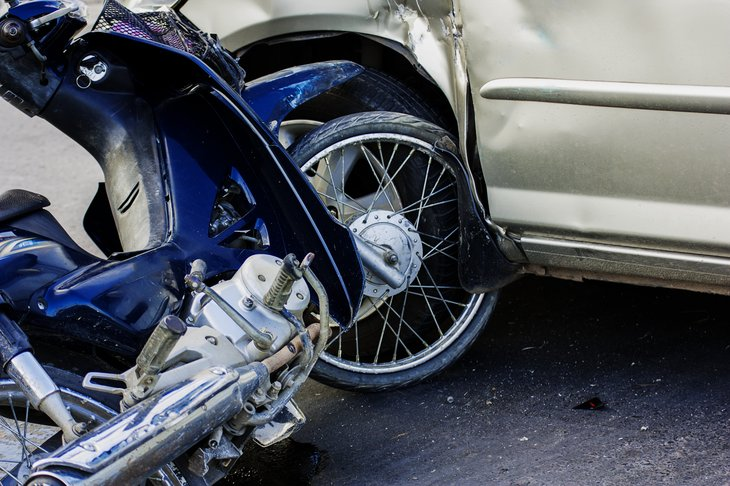 Motorcycle in collision with car.