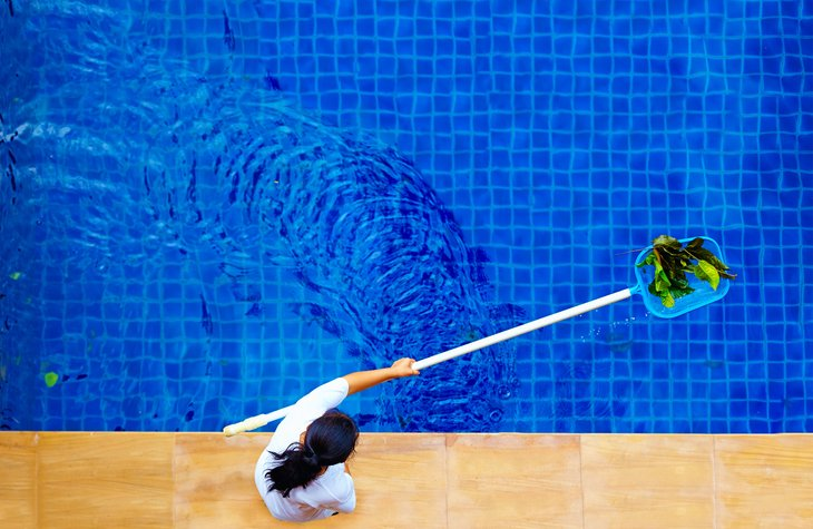 Girl Cleaning Pool