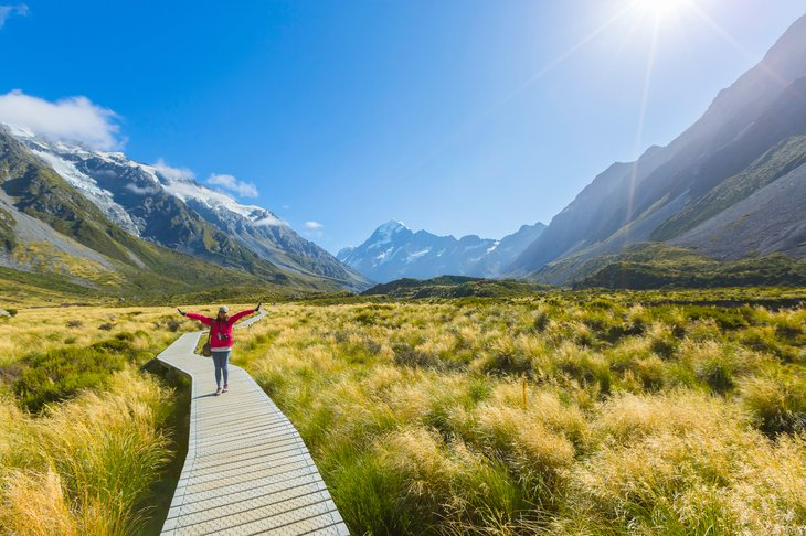 A woman hikes through Aoraki/Mount Cook National Park in New Zealand