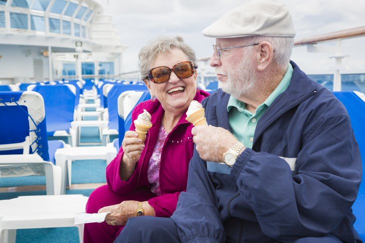 A couple eats ice cream on a cruise ship deck