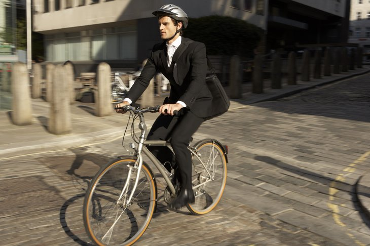 A man commutes to work by bicycle