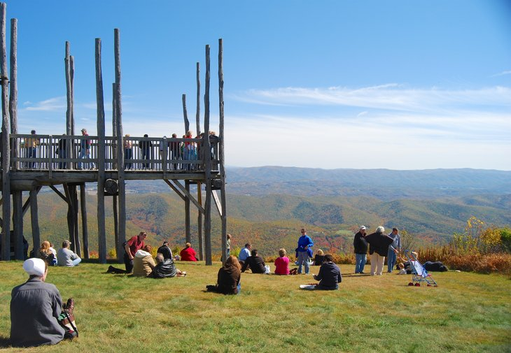 Passengers of the Cass Scenic Railroad State Park train enjoy the view from the Bald Knob overlook in Back Allegheny Mountain, West Virginia