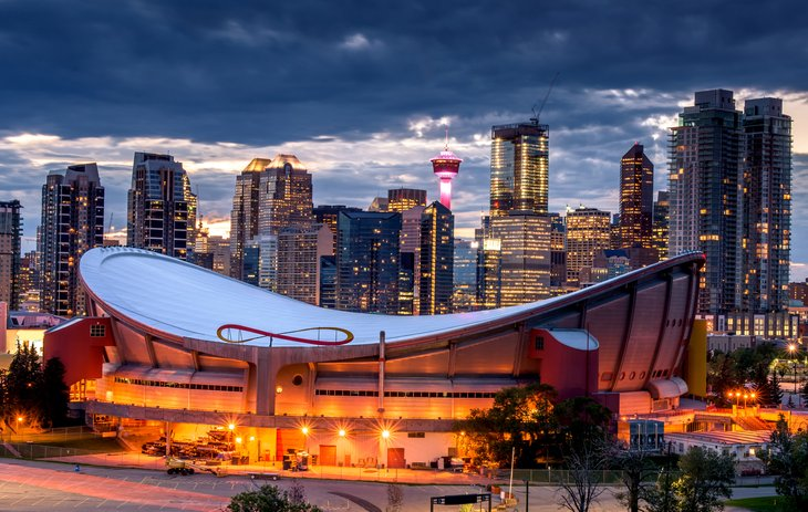 Nighttime view of Calgary, with Saddledome in the foreground