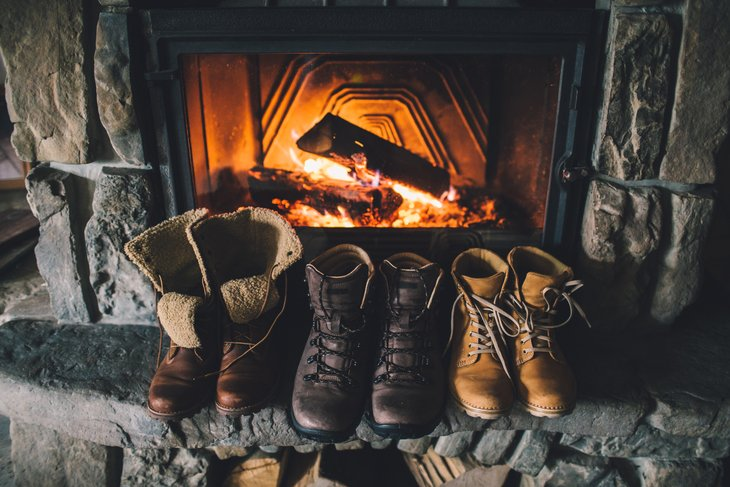 Boots drying in front of fire
