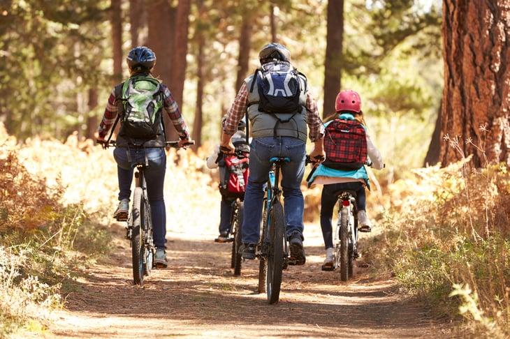 Family biking in the woods