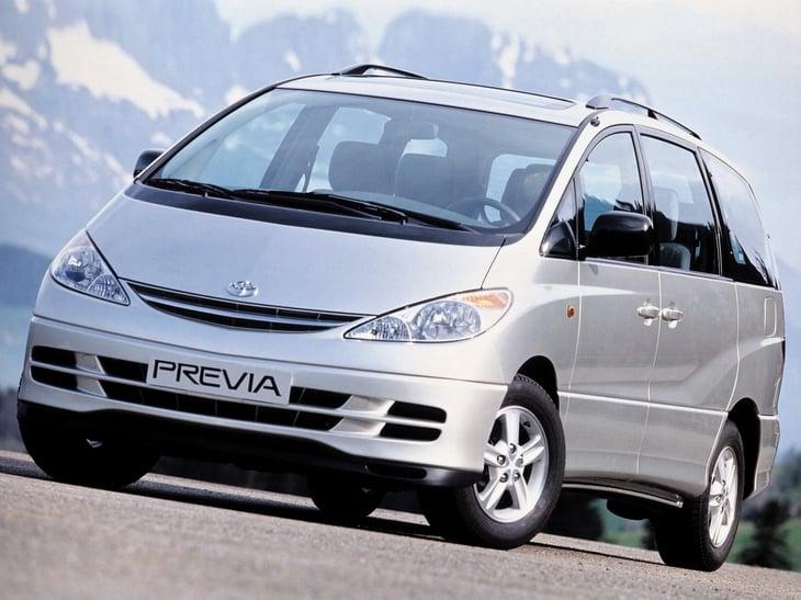 Toyota Previa on mountain road.