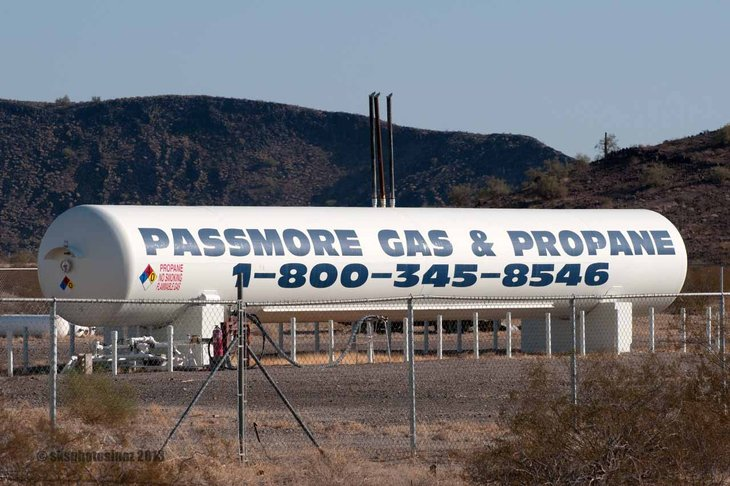 Truck with Passmore Gas & Propane logo on its side.