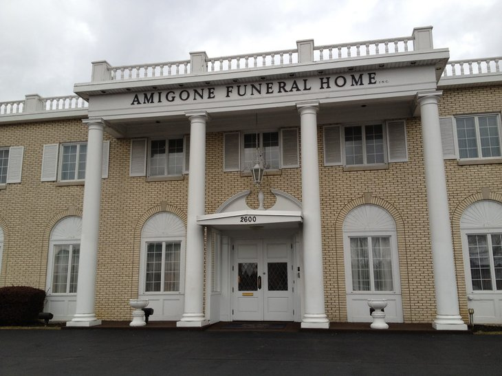 Large Building with the Name Amigone Funeral Home.