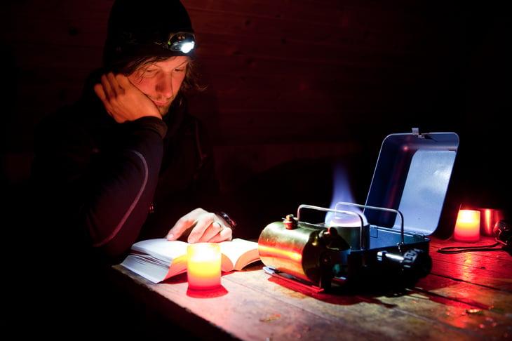 Man reading by headlamp