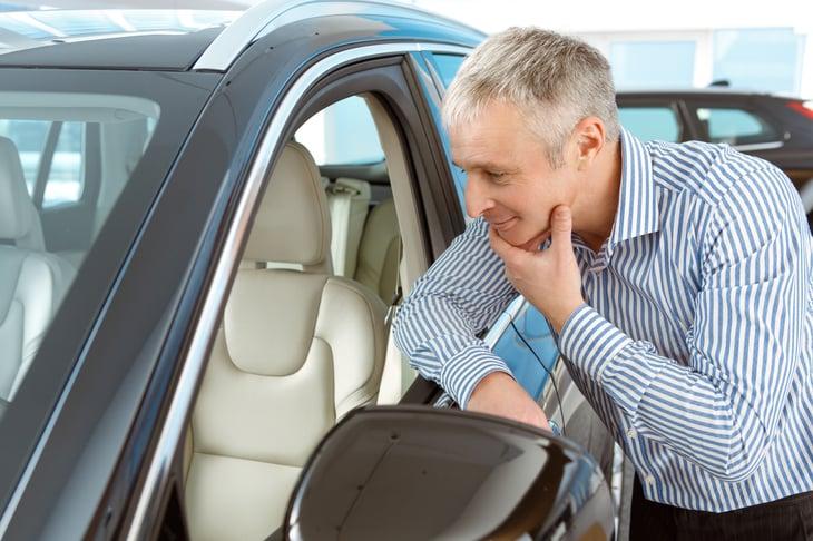 Man looking at car
