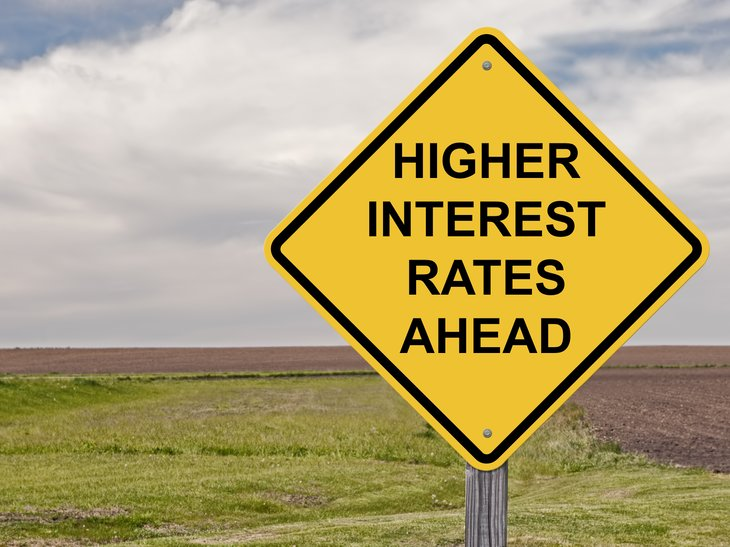 Road sign reading 'Higher interest rates ahead'