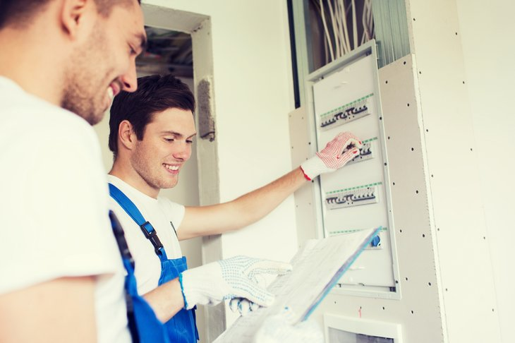 Men looking at electrical panel