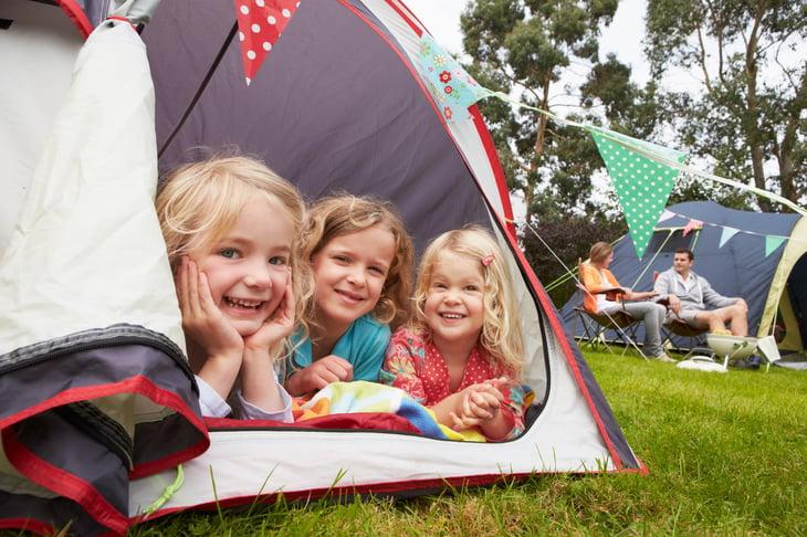 Three kids in a tent