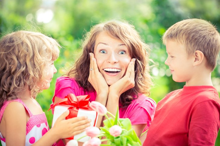 Surprised woman with two young children