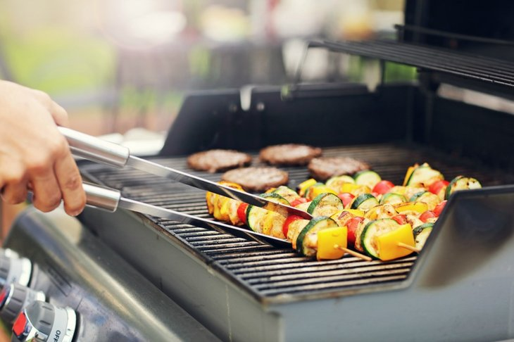 Skewers of veggies on grill.