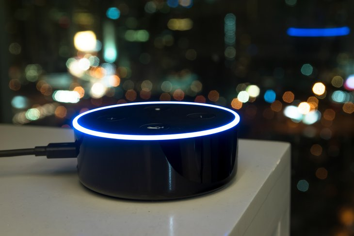 An Echo Dot device by Amazon sits on a table